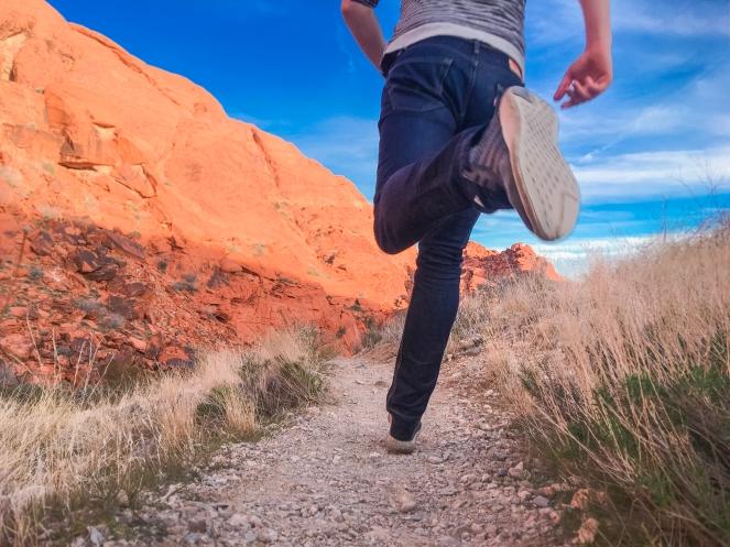 Man Running Outside Along Desert Trail